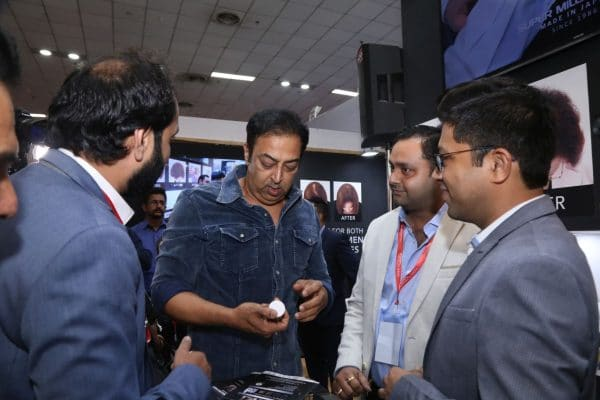 Vindu Dara Singh checking out Super Million Hair Dark Brown for himself.